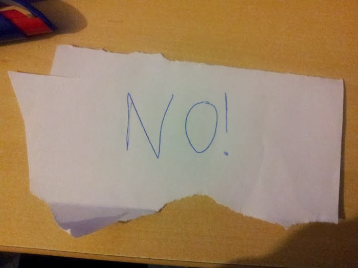 The word no written on a bit of paper